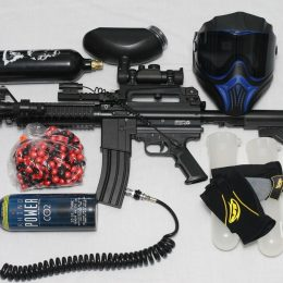 A gun, mask and other assorted gear from the best paintball brands.