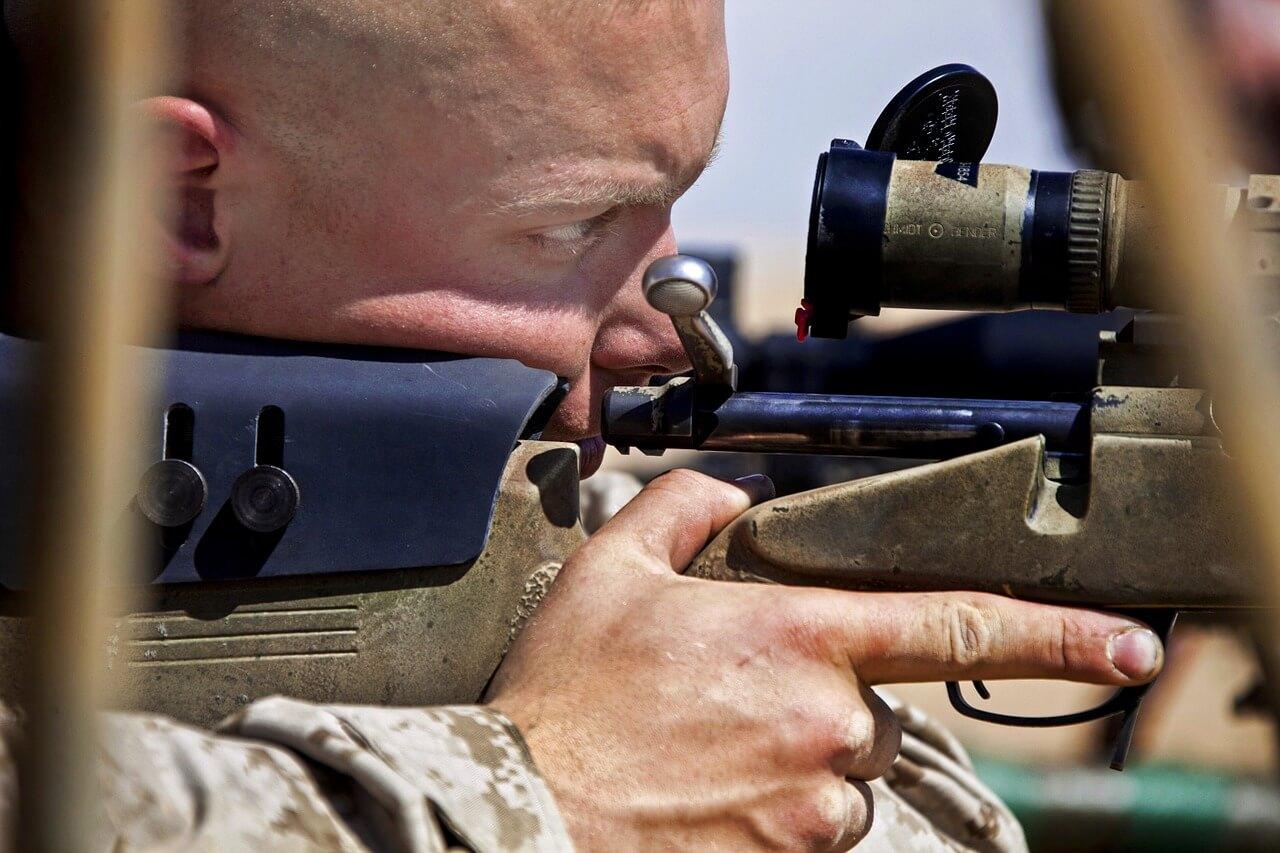 man with airsoft sniper rifle gun