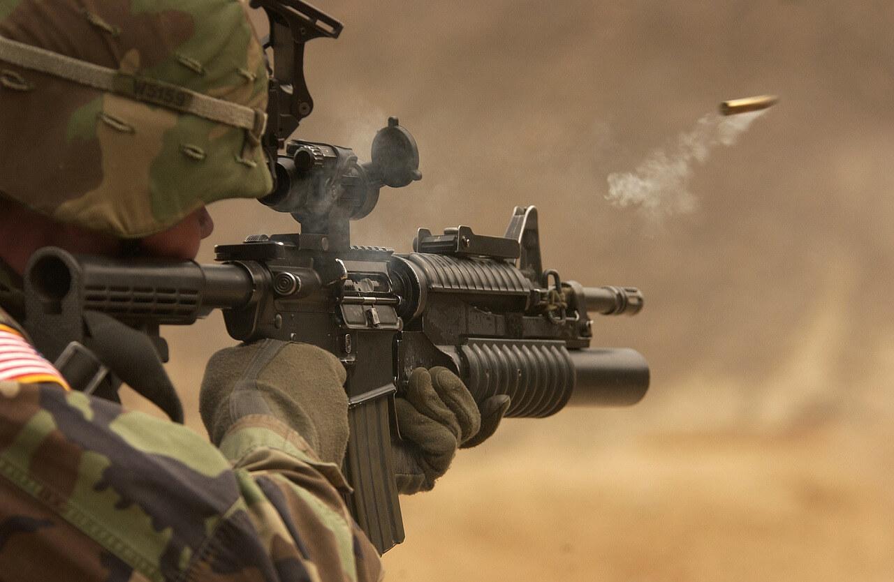 soldier with submachine gun rifle