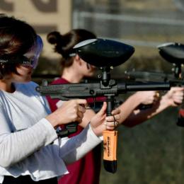 Girls using paintball guns