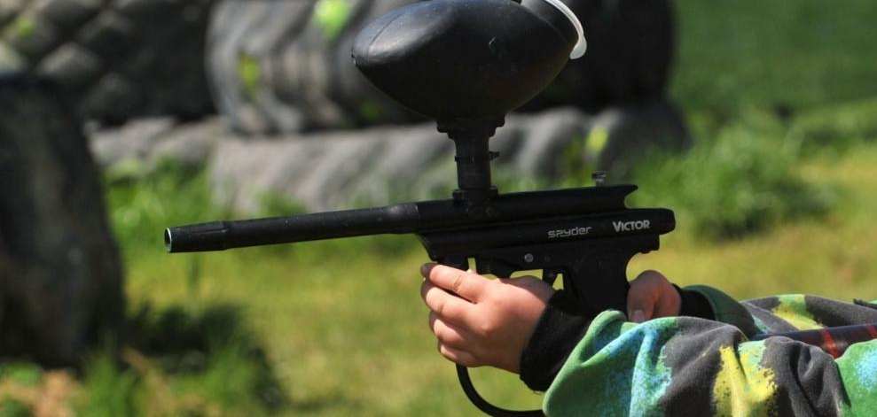 boy holding spyder paintball
