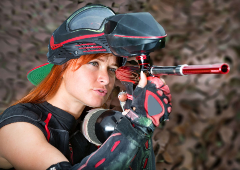 girl playing paintball gun
