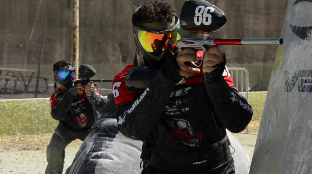 boys playing paintball gun wearing dye googles