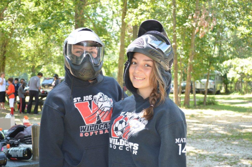 two girls wearing paintball googles